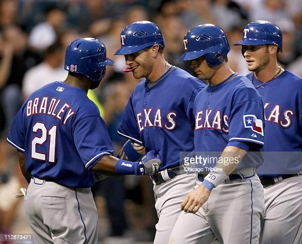Texas Rangers left to right Milton Bradley congratulates Josh Hamilton who hit a threerun home run that scored Michael Young and Jarrod...