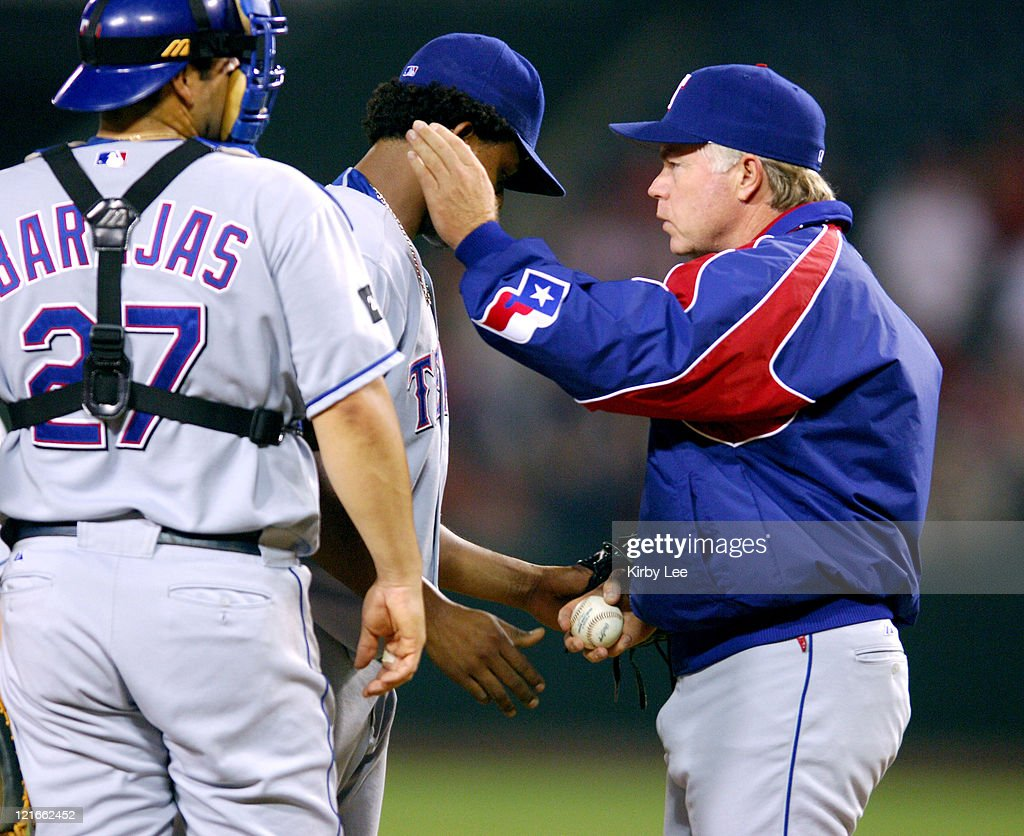 Texas Rangers manager Buck Showalter removes reliever Edison Volquez as catcher Rod Barajas watches in the sixth inning of 7-4 loss to the Los Angeles Angels of Anaheim at Angel Stadium in Anaheim, Calif. on Thursday, Sept. 22, 2005.