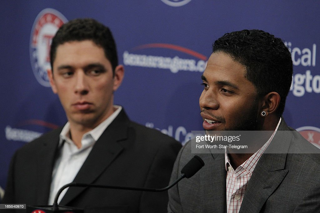 Texas Rangers manager GM and Baseball Operations President Jon Daniels, left, attends a press conference with Elvis Andrus at Rangers Ballpark in Arlington, Texas, Thursday, April 4, 2013. Andrus signed an eight-year contract extension through 2022 with a vesting option for a ninth season.