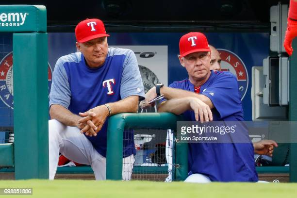 Texas Rangers Manager Jeff Banister and benchcoach Steve Buechele look on from the dugout steps during the MLB game between the Toronto Blue Jays and...