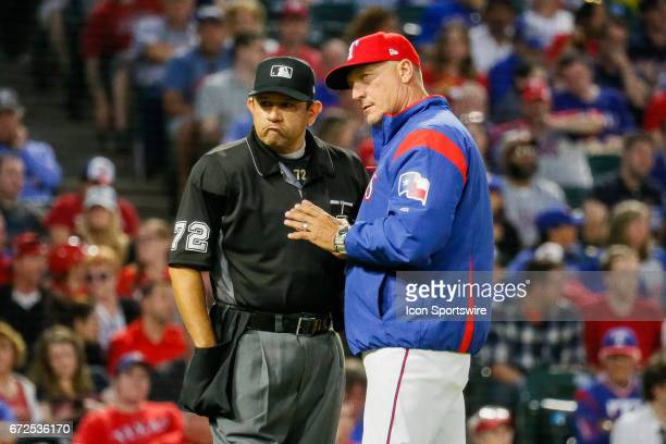 Texas Rangers Manager Jeff Banister and Home Plate Umpire Alfonso Marquez discuss a strike out call during the MLB game between the Minnesota Twins...