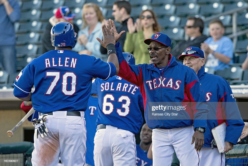 Texas Rangers manager Ron Washington congratulates Brandon Allen (70), after he scored on a home run by temmate Yangervis Solarte to tie a spring training game in the ninth inning against the Kansas City Royals in Surprise, Arizona, Friday, February 22, 2013. The game ended in a 5-5 tie.