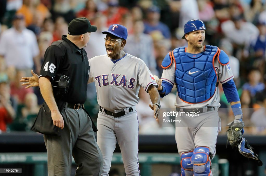 Texas Rangers manager <a gi-track='captionPersonalityLinkClicked' href=/galleries/search?phrase=Ron+Washington&family=editorial&specificpeople=225012 ng-click='$event.stopPropagation()'>Ron Washington</a> #38 gets between <a gi-track='captionPersonalityLinkClicked' href=/galleries/search?phrase=A.J.+Pierzynski&family=editorial&specificpeople=204486 ng-click='$event.stopPropagation()'>A.J. Pierzynski</a> #12 of the Texas Rangers and home plate umpire <a gi-track='captionPersonalityLinkClicked' href=/galleries/search?phrase=Ron+Kulpa&family=editorial&specificpeople=2141033 ng-click='$event.stopPropagation()'>Ron Kulpa</a> after Pierzynaski was ejected from the game for questioning a ball four call on Jonathan Villar #6 of the Houston Astros at Minute Maid Park on August 12, 2013 in Houston, Texas.