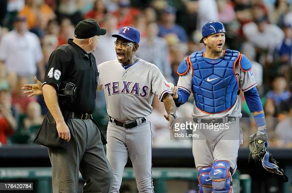 Texas Rangers manager Ron Washington gets between AJ Pierzynski of the Texas Rangers and home plate umpire Ron Kulpa after Pierzynaski was ejected...