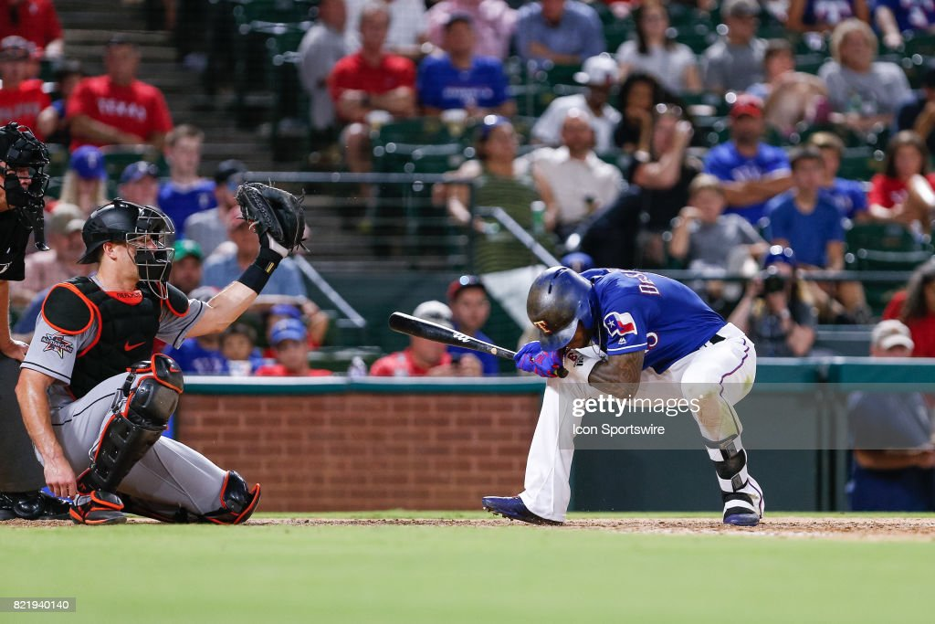 Texas Rangers Outfield Delino DeShields (3) ducks as a ball is throw over his head during the MLB game between the Miami Marlins and Texas Rangers on July 24, 2017 at Globe Life Park in Arlington, TX. Miami defeats Texas 4-0.