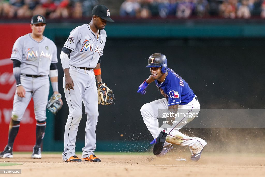 Texas Rangers Outfield Delino DeShields (3) slides into second base on a wild throw during the MLB game between the Miami Marlins and Texas Rangers on July 24, 2017 at Globe Life Park in Arlington, TX. Miami defeats Texas 4-0.