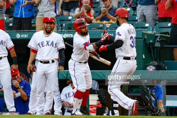 Texas Rangers outfielder Nomar Mazara is congratulated by teammates after he hits a home run during the MLB game between the Toronto Blue Jays and...