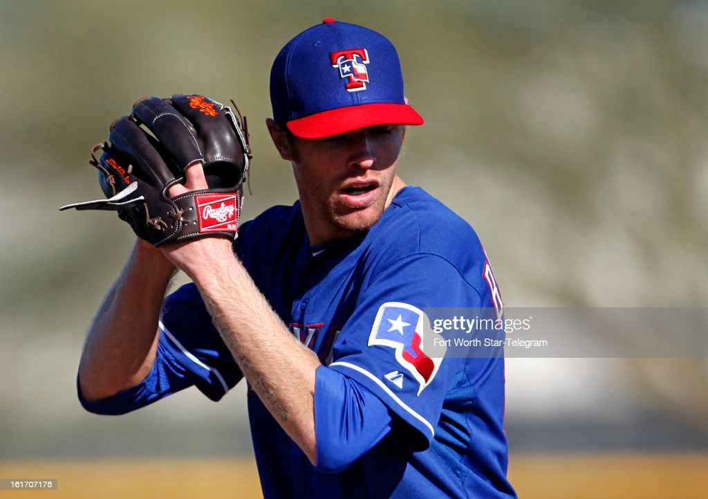 Texas Rangers pitcher Collin Balester throws during spring training in Surprise, Arizona, on Thursday, February 14, 2013.
