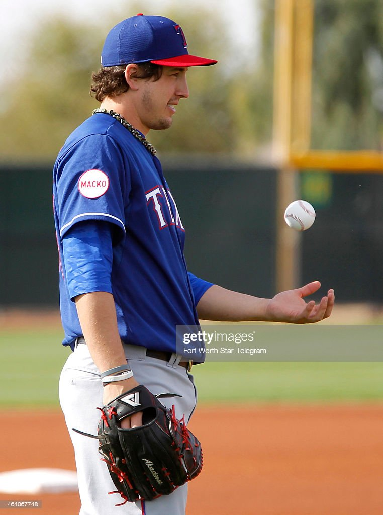 Texas Rangers pitcher <a gi-track='captionPersonalityLinkClicked' href=/galleries/search?phrase=Derek+Holland+-+Baseball+Player&family=editorial&specificpeople=8003703 ng-click='$event.stopPropagation()'>Derek Holland</a> as the team's pitchers and catchers report for training camp in Surprise, Az., on Saturday, Feb. 21, 2015.