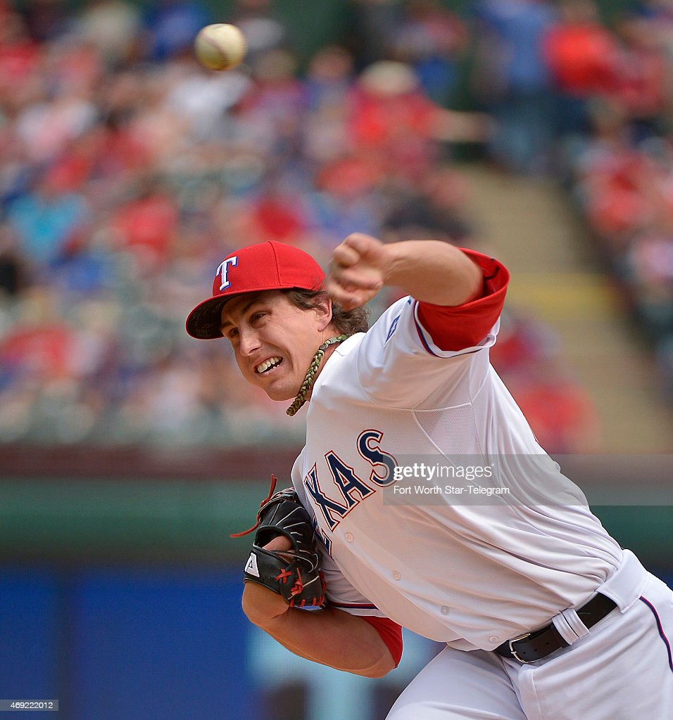 Texas Rangers pitcher <a gi-track='captionPersonalityLinkClicked' href=/galleries/search?phrase=Derek+Holland+-+Baseball+Player&family=editorial&specificpeople=8003703 ng-click='$event.stopPropagation()'>Derek Holland</a> works in the first inning against the Houston Astros at Globe Life Park in Arlington, Texas, on Friday, April 10, 2015. The Astros won, 5-1.