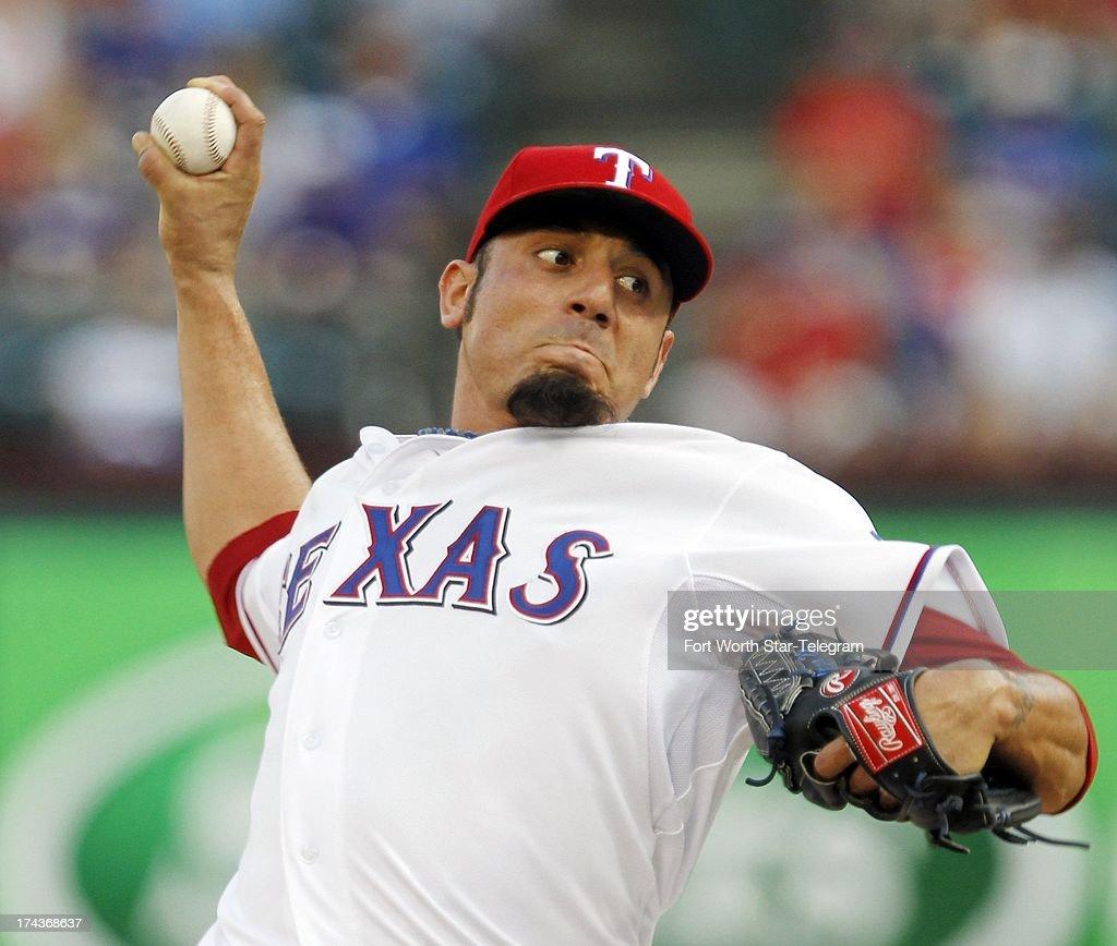 Texas Rangers pitcher Matt Garza throws against the New York Yankees at the Rangers Ballpark in Arlington on Wednesday, July 24, 2013 in Arlington, Texas.