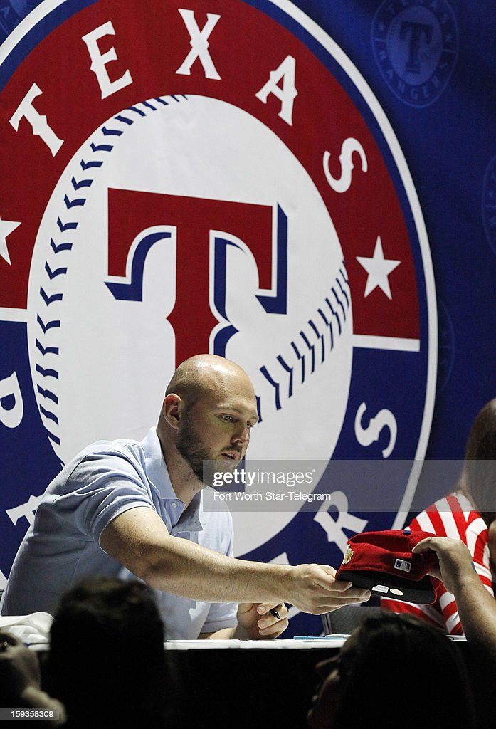 Texas Rangers pitcher Matt Harrison signs autographs at the team's Fan Fest in the Arlington Convention Center on Saturday, January 12, 2013, in Arlington, Texas.