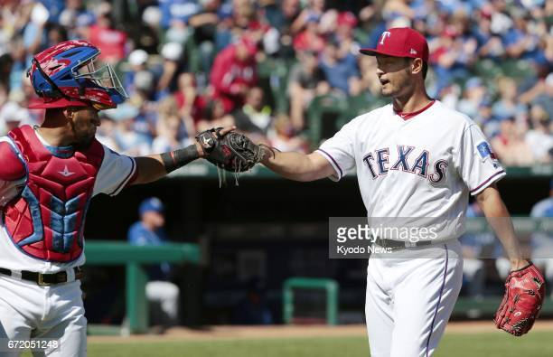 Texas Rangers pitcher Yu Darvish and catcher Robinson Chirinos bump fists after ending the sixth inning against the Kansas City Royals at Globe Life...