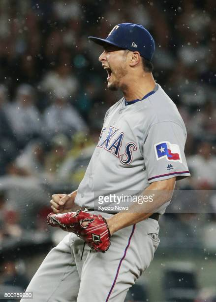Texas Rangers pitcher Yu Darvish shouts after a strikeout in the seventh inning of a game against the New York Yankees at Yankee Stadium in New York...