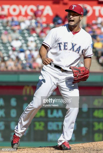 Texas Rangers pitcher Yu Darvish shouts after striking out Whit Merrifield in the eighth inning of a 52 win over the Kansas City Royals at Globe Life...