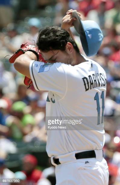 Texas Rangers pitcher Yu Darvish wipes his sweat after allowing a tworun homer in the first inning of a 73 loss to the Seattle Mariners at Global...