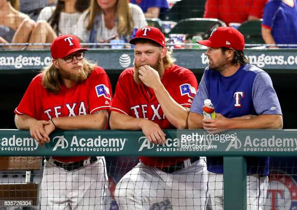 Texas Rangers pitchers AJ Griffin Andrew Cashner and Cole Hamels chat with each other during the MLB game between the Chicago White Sox and Texas...