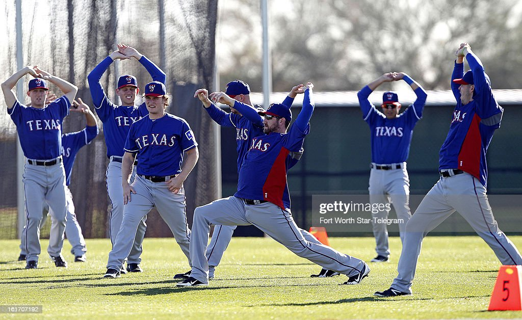 Texas Rangers pitchers stretch during spring training in Surprise, Arizona, on Thursday, February 14, 2013.