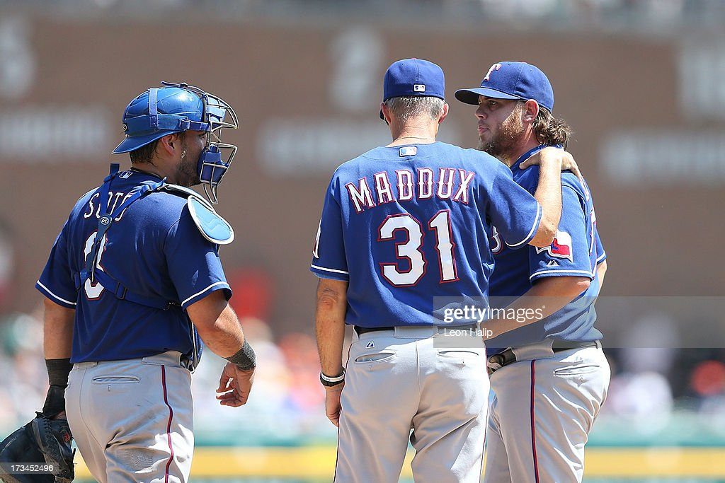 Texas Rangers pitching coach <a gi-track='captionPersonalityLinkClicked' href=/galleries/search?phrase=Mike+Maddux&family=editorial&specificpeople=556746 ng-click='$event.stopPropagation()'>Mike Maddux</a> #31 talks with pitcher Cory Burns #57 and catcher <a gi-track='captionPersonalityLinkClicked' href=/galleries/search?phrase=Geovany+Soto&family=editorial&specificpeople=743668 ng-click='$event.stopPropagation()'>Geovany Soto</a> #8 during the seventh inning of the game against the Detroit Tigers at Comerica Park on July 14, 2013 in Detroit, Michigan. The Tigers defeated the Rangers 5-0.