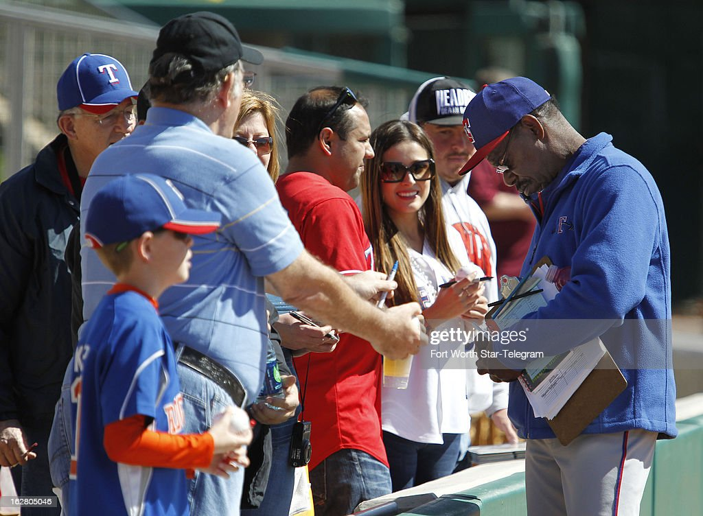 Texas Rangers Rangers manager Ron Washington signs autographis for fans prior to action against the Chicago White Sox in Glendale, Arizona, Wednesday, February 27, 2013. Chicago won, 8-4.