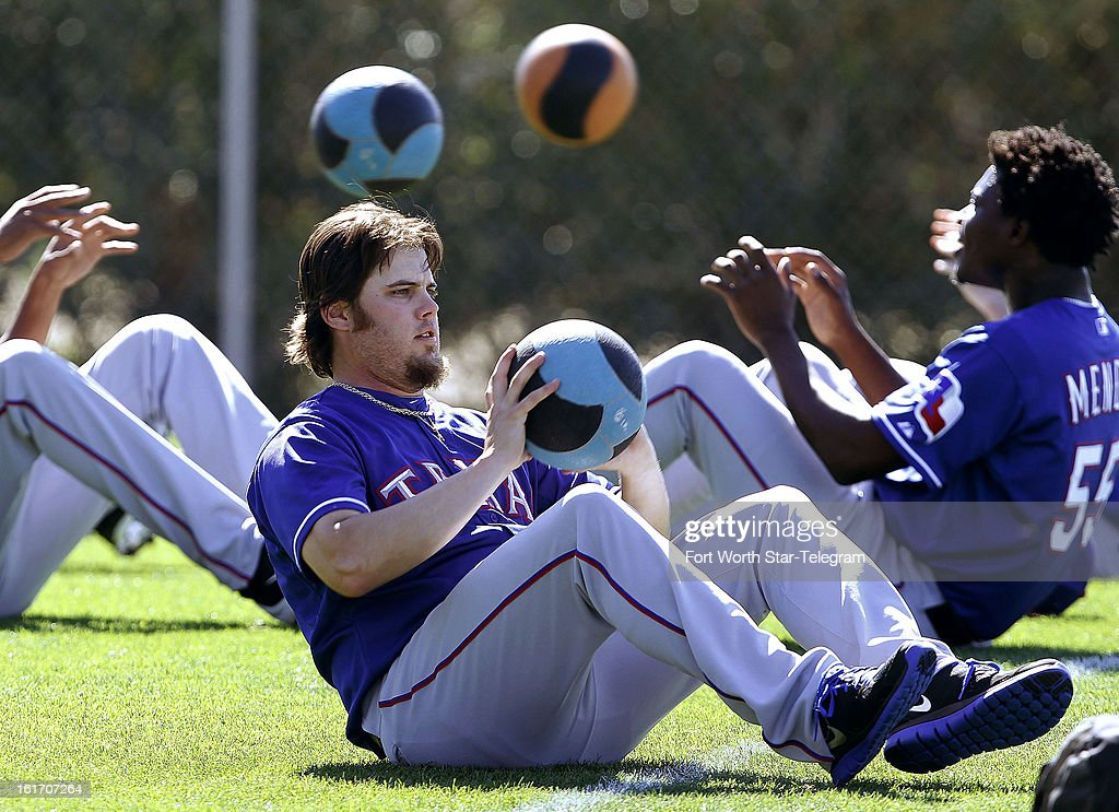 Texas Rangers relief pitcher Cory Burns at work with other pitchers in fitness drills during spring training in Surprise, Arizona, on Thursday, February 14, 2013.