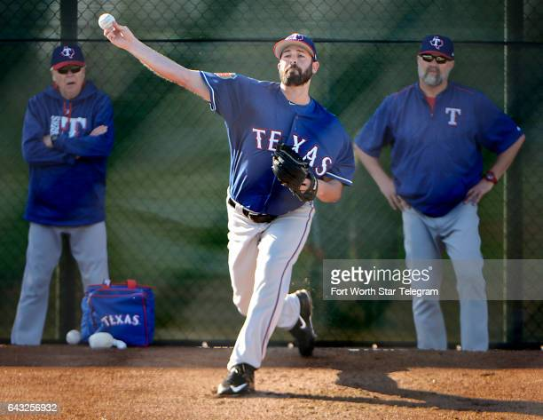 Texas Rangers relief pitcher Mike Hauschild throws a bullpen session during practice at Rangers spring training on Monday Feb 20 2017 in Surprise Ariz