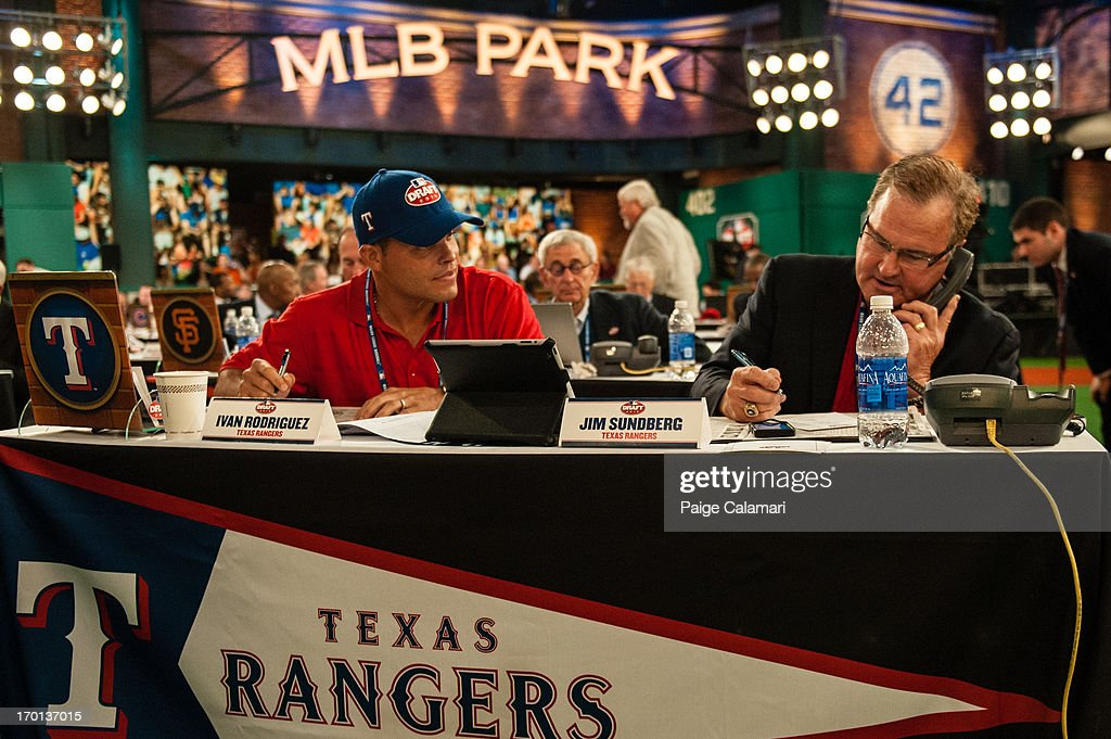 Texas Rangers representatives Ivan Rodriguez and Jim Sundberg are seen during the 2013 First-Year Player Draft at MLB Network's Studio 42 on June 6, 2013 in Secaucus, New Jersey.