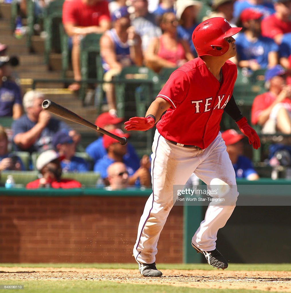 Texas Rangers right fielder Shin-Soo Choo (17) tosses his bat after hitting a double during the seventh inning on Sunday, June 26, 2016, at Globe Life Park in Arlington, Texas.