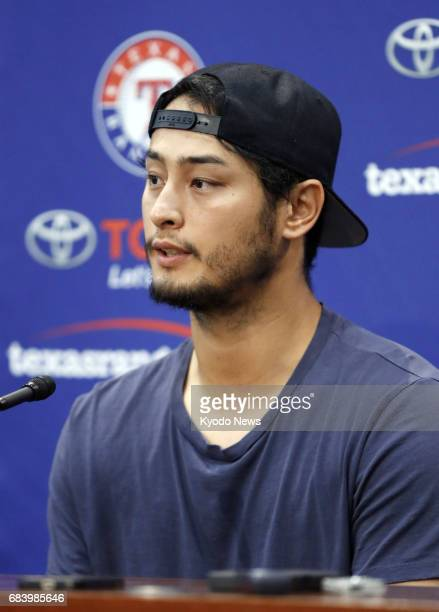 Texas Rangers righthander Yu Darvish attends a press conference in Arlington Texas on May 16 after beating the Philadelphia Phillies 51 his 50th win...