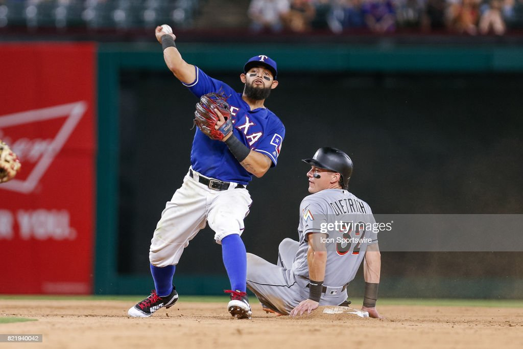 Texas Rangers Second base Rougned Odor (12) attempts to turn a double play but throws the ball wide during the MLB game between the Miami Marlins and Texas Rangers on July 24, 2017 at Globe Life Park in Arlington, TX. Miami defeats Texas 4-0.