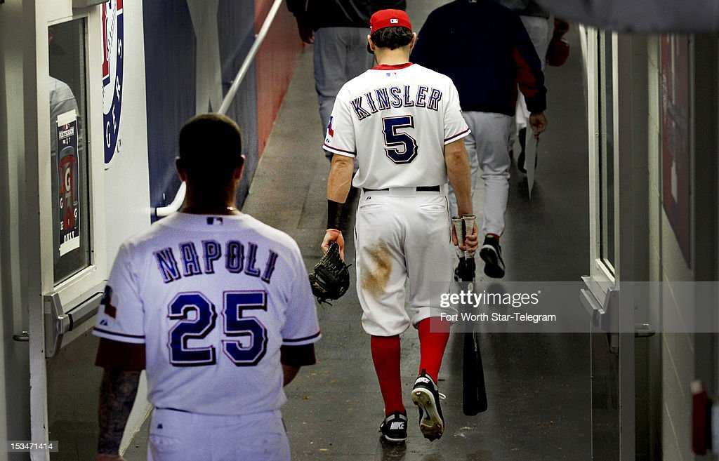 Texas Rangers second baseman Ian Kinsler (5) and catcher Mike Napoli (25) leave the dugout after a 5-1 loss against the Baltimore Orioles in Wild Card playoff action at Rangers Ballpark in Arlington on Friday, October 5, 2012, in Arlington, Texas.