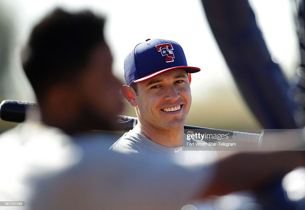 Texas Rangers second baseman Ian Kinsler, right, shares a laugh with shortstop Elvis Andrus at the batting cage during spring training in Surprise, Arizona, on Thursday, February 14, 2013.