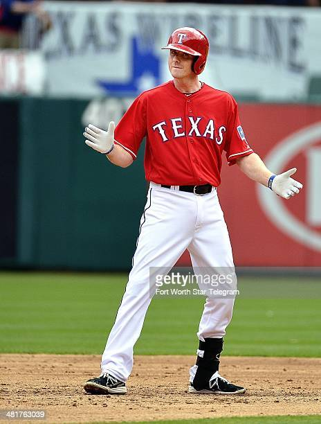 Texas Rangers second baseman Josh Wilson celebrates hitting a 3 rbi double during the second inning The Philadelphia Phillies beat the Texas Rangers...