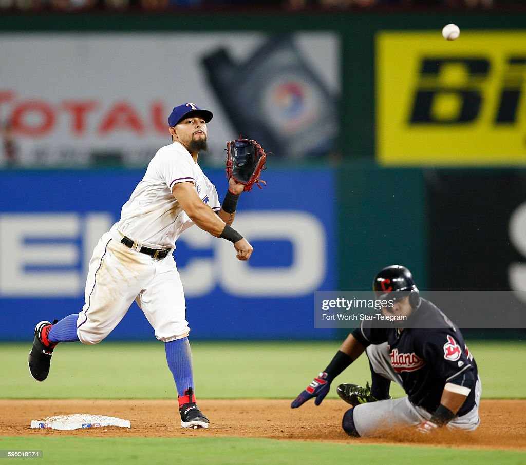 Texas Rangers second baseman Rougned Odor throws to first base after forcing out Cleveland Indians designated hitter Carlos Santana turning a double...