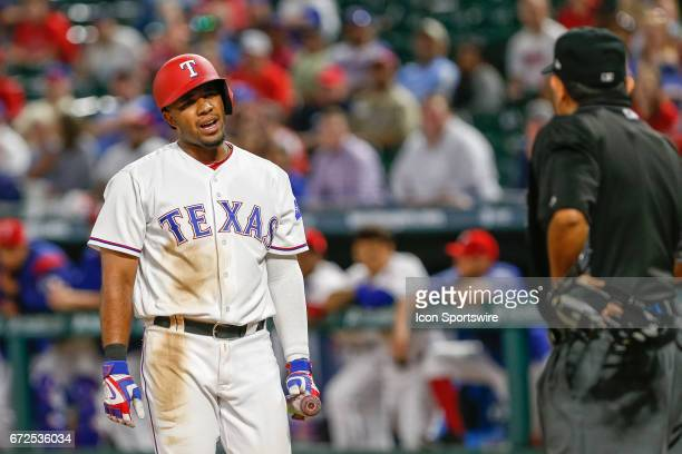 Texas Rangers Shortstop Elvis Andrus complains to the umpire after striking out during the bottom of the 9th inning of MLB game between the Minnesota...