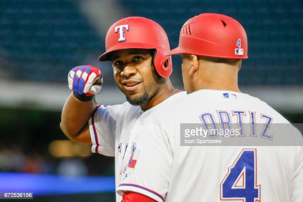 Texas Rangers Shortstop Elvis Andrus gestures to the dugout after hitting a single during the MLB game between the Minnesota Twins and Texas Rangers...