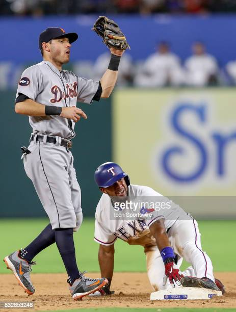 Texas Rangers shortstop Elvis Andrus slides into second base in front of Tigers Ian Kinsler during the MLB game between the Detroit Tigers and Texas...