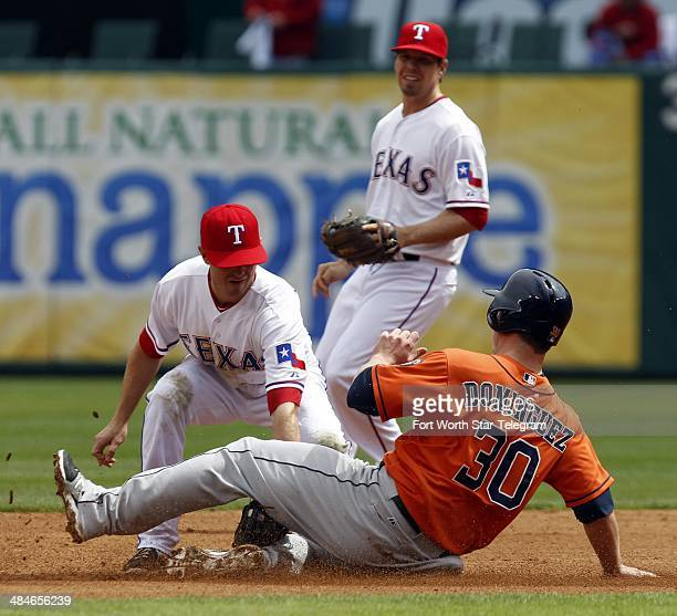 Texas Rangers shortstop Josh Wilson makes the tag on the Houston Astros' Matt Dominguez as Donnie Murphy backs him up in the fifth inning at Globe...