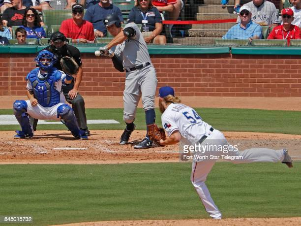 Texas Rangers starting pitcher Andrew Cashner strikes out the New York Yankees' Aaron Judge swinging to end the top of the fourth inning at Globe...