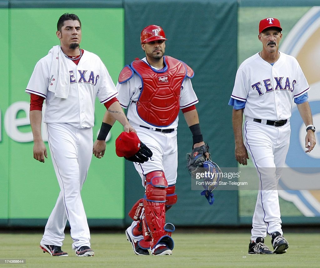 Texas Rangers starting pitcher Matt Garza, left, catcher Geovany Soto and pitching coach Mike Maddux, right, walk from the bullpen to the dugout before the start of action against the New York Yankees at the Rangers Ballpark in Arlington on Wednesday, July 24, 2013 in Arlington, Texas.