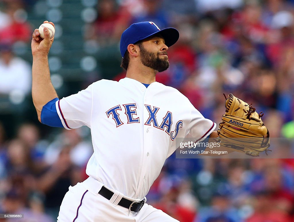 Texas Rangers starting pitcher Nick Martinez works the first inning against the Boston Red Sox at Globe Life Park in Arlington, Texas, on Friday, June 24, 2016.