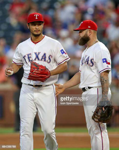 Texas Rangers starting pitcher Yu Darvish chats with Mike Napoli during the MLB game between the Philadelphia Phillies and Texas Rangers on May 16...