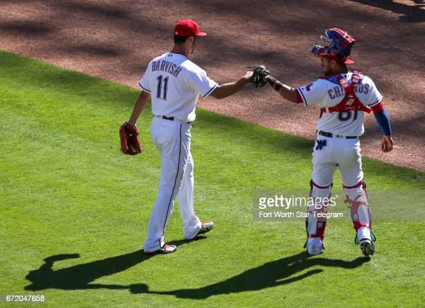 Texas Rangers starting pitcher Yu Darvish fist bumps catcher Robinson Chirinos after working the seventh inning against the Kansas City Royals on...
