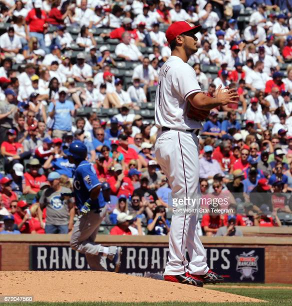 Texas Rangers starting pitcher Yu Darvish reacts after giving up a home run to Kansas City Royals' Jorge Bonifacio in the third inning on Sunday...