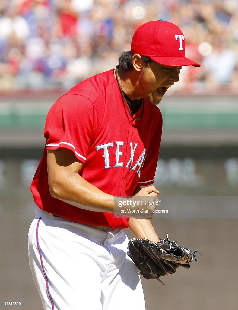 Texas Rangers starting pitcher Yu Darvish (11) reacts after striking out Boston Red SoxÕs Pedro Ciriaco (23) in Arlington, Texas, Sunday, May 5, 2013.