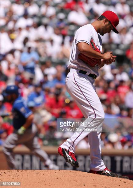 Texas Rangers starting pitcher Yu Darvish walks off the back of the mound after giving up a home run to Kansas City Royals' Mike Moustakas in the...