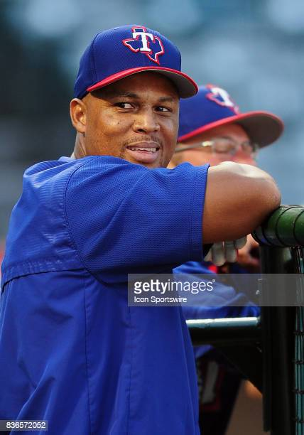 Texas Rangers third baseman Adrian Beltre leans on the batting cage during batting practice before a game against the Los Angeles Angels of Anaheim...