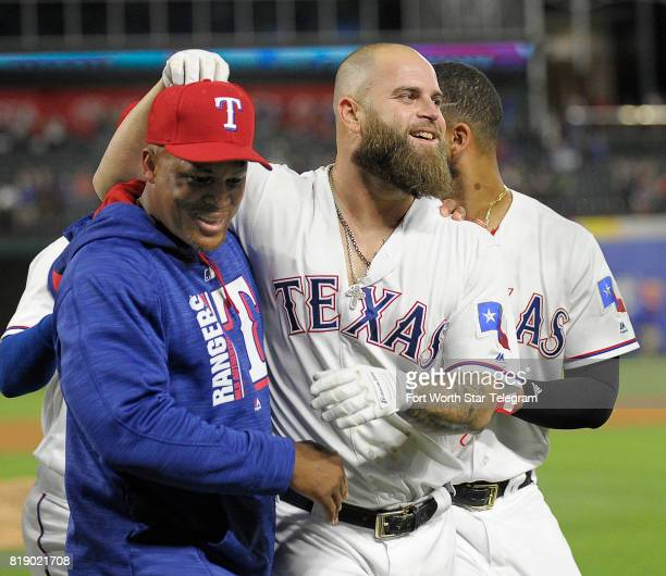 Texas Rangers third baseman Adrian Beltre left celebrates with designated hitter Mike Napoli who hit a walkoff home run against the San Diego Padres...