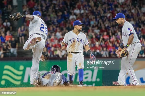 Texas Rangers third baseman Adrian Beltre steps over Minnesota Twins designated hitter Kennys Vargas after tagging him out in a rundown as Texas...