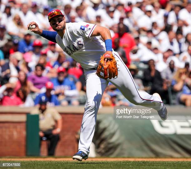 Texas Rangers third baseman Joey Gallo fields a ground ball hit by Kansas City Royals' Whit Merrifield in the third inning on Sunday April 23 2017 at...